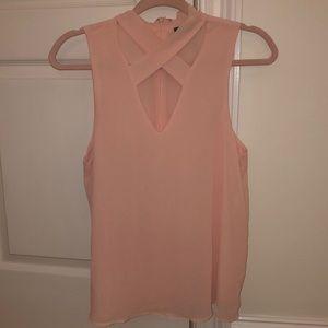 light pink criss cross blouse